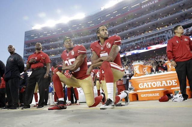 49ers Eric Reid (L) and Colin Kaepernick maintained their stance and protest on Monday. (AP)