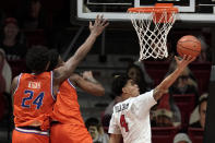 San Diego State guard Trey Pulliam (4) shoots against Boise State forward Abu Kigab (24) and guard Devonaire Doutrive, second from left, during the second half of an NCAA college basketball game Saturday, Feb 27, 2021, in San Diego. (AP Photo/Gregory Bull)