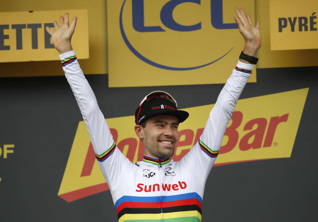 FILE - In this Saturday July 28, 2018 file photo, stage winner Netherlands' Tom Dumoulin celebrates on the podium after the twentieth stage of the Tour de France cycling race, in Espelette, France. Dumoulin says he will not start this years Tour de France as he struggles to regain fitness following a fall last month in the Giro dItalia. Dumoulins Team Sunweb announced Thursday, June 20, 2019 that Dumoulin, who finished second behind Geraint Thomas in last years Tour, would not be ready to start this years race on July 7 in Brussels. (AP Photo/Christophe Ena, file)