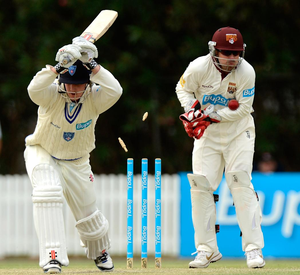 BRISBANE, AUSTRALIA - NOVEMBER 03:  Nick Maddinson of the Blues is clean bowled by the bowling of Nathan Hauritz of the Bulls during the Sheffield Shield match between the Queensland Bulls and the New South Wales Blues at Allan Border Field on November 3, 2012 in Brisbane, Australia. (Photo by Bradley Kanaris/Getty Images)