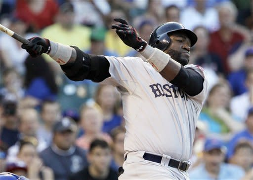 Boston Red Sox's David Ortiz hits a one-run single against the Chicago Cubs during the first inning of an interleague baseball game in Chicago, Sunday, June 17, 2012. (AP Photo/Nam Y. Huh)