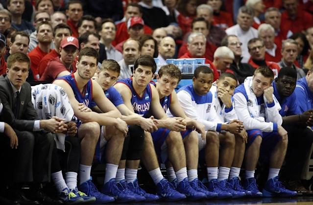 American players watch from the bench during the second half of a second-round game against the Wisconsin in the NCAA college basketball tournament Thursday, March 20, 2014, in Milwaukee. Wisconsin won 75-35. (AP Photo/Jeffrey Phelps)