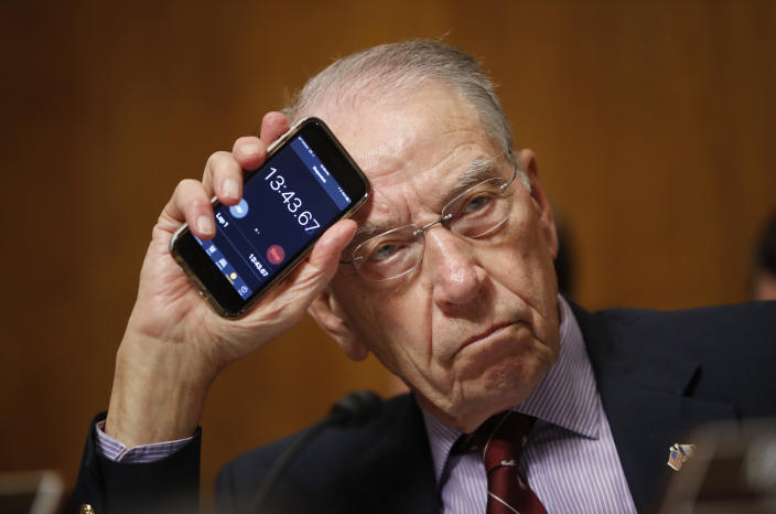 "<span class=""s1"">Chuck Grassley holds up a smartphone timer to show Sen. Cory Booker how long he has been speaking during the Kavanaugh hearings in September. (Photo: Pablo Martinez Monsivais/AP)</span>"