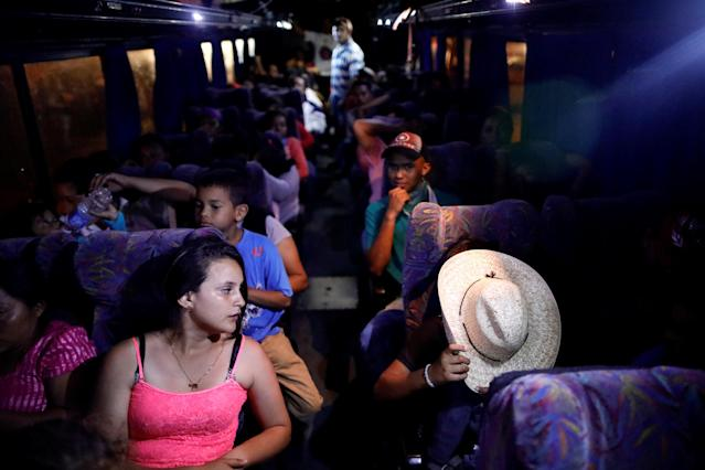 <p>Central American migrants, part of a caravan moving through Mexico toward the U.S. border, sit on a bus bound for Puebla, in Matias Romero, Mexico April 5, 2018. (Photo: Henry Romero/Reuters) </p>