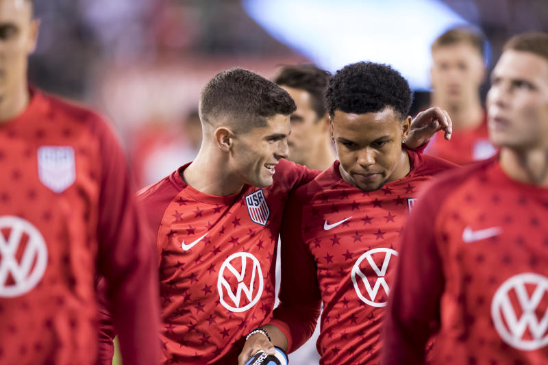 Christian Pulisic (left), Weston McKennie and the USMNT's loaded young roster is finally in camp together for friendlies in Europe this week and next. (Photo by Ira L. Black/Corbis via Getty Images)