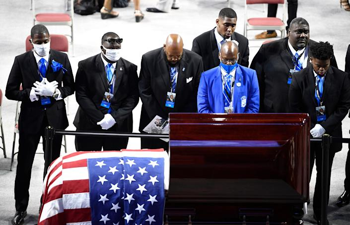 """Members of John Lewis' fraternity, Phi Beta Sigma, pay their respects after """"The Boy From Troy"""" memorial service celebrating the civil rights icon and U.S. Congressman at Trojan Arena Saturday, July 25, 2020 in Troy, Ala."""