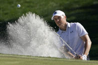 Jordan Spieth hits from the bunker on the ninth hole during the first round of the The Players Championship golf tournament Thursday, March 11, 2021, in Ponte Vedra Beach, Fla. (AP Photo/John Raoux)