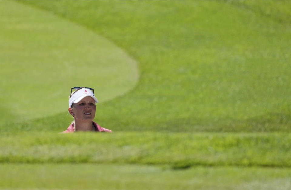 Nanna Koerstz Madsen, of Denmark, studies her shot from a bunker on the 9th green during the second round of the women's golf event at the 2020 Summer Olympics, Thursday, Aug. 5, 2021, at the Kasumigaseki Country Club in Kawagoe, Japan. (AP Photo/Andy Wong)