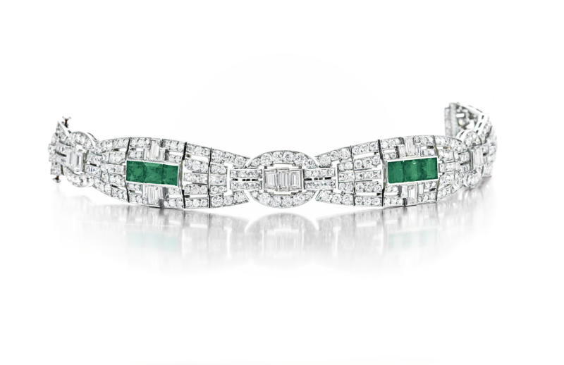 In this undated photo provided by Christie's Auction House in New York, a circa 1925 art deco emerald and diamond Cartier bracelet from the estate of the late copper heiress Huguette Clark is shown. The piece sold for $110,500.00 at Christies' New York Magnificent Jewels auction on Tuesday, April 17, 2012. (AP Photo/Christie's Auction House)