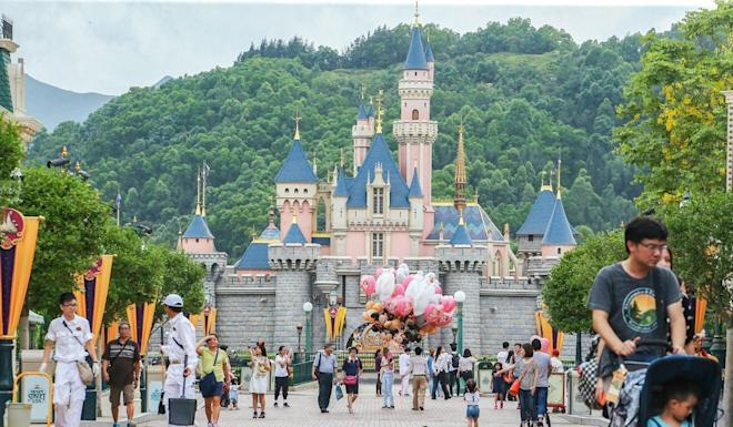 Visitors stroll through Hong Kong Disneyland. Photo: Felix Wong