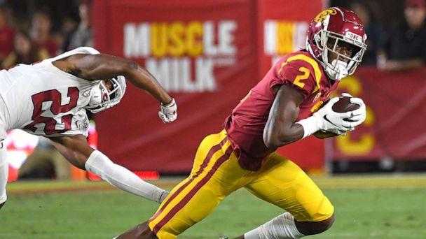PHOTO: Wide receiver Devon Williams of the USC Trojans holds on to pass as he breaks loose from cornerback Obi Eboh of the Stanford Cardinal for a first down in the first half of the game on September 7, 2019, in Los Angeles. (Jayne Kamin-Oncea/Getty Images)