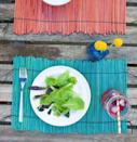 """<p>Tropical and colorful, a pile of skewers gets a whole new cookout role with a little dye and some jewelry cord. </p><p><em><a href=""""http://www.thehomesteady.com/my-blog/2014/04/diy-dyed-wood-placemats.html"""" rel=""""nofollow noopener"""" target=""""_blank"""" data-ylk=""""slk:Get the tutorial at The Homesteady »"""" class=""""link rapid-noclick-resp"""">Get the tutorial at The Homesteady »</a></em> </p>"""