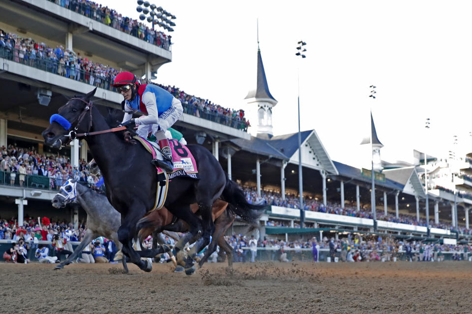 LOUISVILLE, KY - MAY 01: Medina Spirit (8) ridden by jockey John Velazquez wins the 147th Running of the Kentucky Derby on May 1, 2021 at Churchill Downs in Louisville, Kentucky. (Photo by Brian Spurlock/Icon Sportswire via Getty Images)