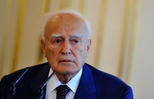 Greek President Karolos Papoulias attends a press conference on September 16, 2013 at the Slovakian Presidential Palace in Bratislava after an official meeting with the Slovakian President