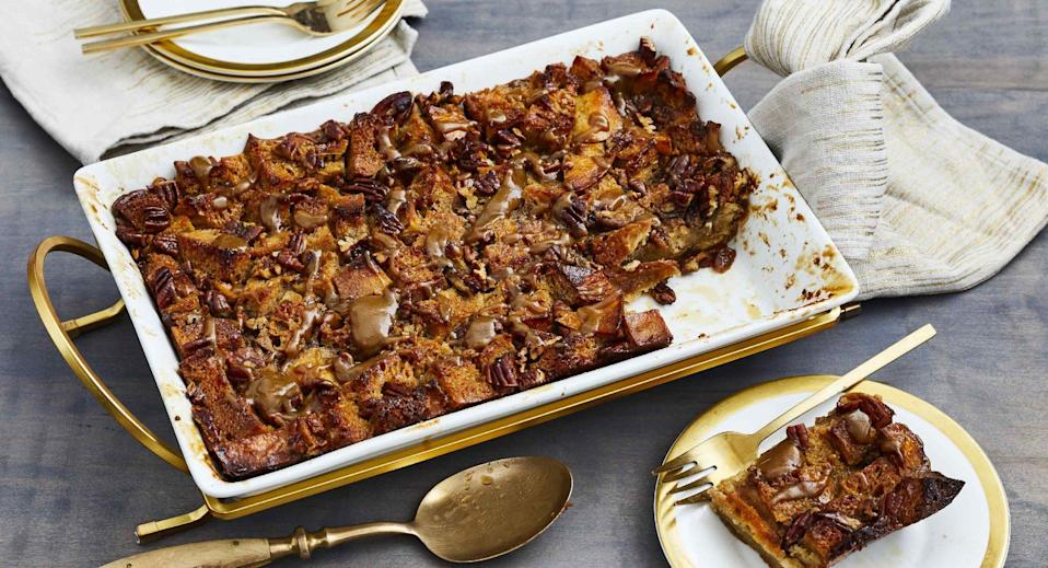 """<p><strong>Recipe: <a href=""""https://www.southernliving.com/recipes/pecan-pie-bread-pudding"""" rel=""""nofollow noopener"""" target=""""_blank"""" data-ylk=""""slk:Pecan Pie Bread Pudding"""" class=""""link rapid-noclick-resp"""">Pecan Pie Bread Pudding</a></strong></p> <p>The most heavenly cross you'll taste all season is this mix of pecan pie and bread pudding that's topped with warm praline sauce and best served with scoops of vanilla ice cream. </p>"""