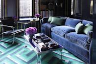<p>This personality-packed den, boasting blue as its dominant color, showcases pops of teal accessories for an interesting mix. </p>