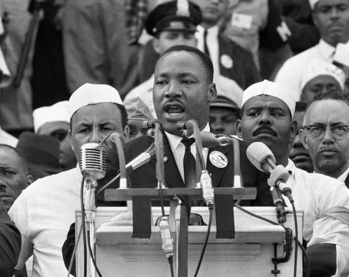 """FILE - In this Aug. 28, 1963 file photo, Dr. Martin Luther King Jr., head of the Southern Christian Leadership Conference, addresses marchers during his """"I Have a Dream"""" speech at the Lincoln Memorial in Washington. The annual celebration of the Martin Luther King Jr. holiday in his hometown in Atlanta is calling for renewed dedication to nonviolence following a turbulent year. The slain civil rights leader's daughter, the Rev. Bernice King, said in an online church service Monday, Jan. 18, 2021, that physical violence and hateful speech are """"out of control"""" in the aftermath of a divisive election followed by a deadly siege on the U.S. Capitol in Washington by supporters of President Donald Trump. (AP Photo/File)"""
