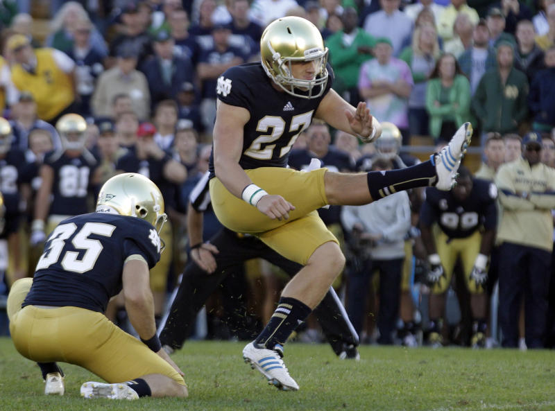 Notre Dame's Kyle Brindza (27) kicks the game-winning field goal from the hold of Ben Turk (35) in the closing seconds of an NCAA college football game against Purdue in South Bend, Ind., Saturday, Sept. 8, 2012. Notre Dame won 20-17. (AP Photo/Michael Conroy)