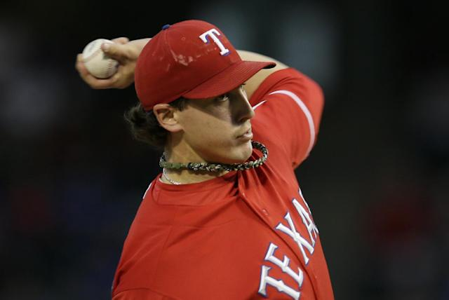 Texas Rangers starting pitcher Derek Holland delivers to the Houston Astros in the first inning of a baseball game, Monday, Sept. 23, 2013, in Arlington, Texas. (AP Photo/Tony Gutierrez)
