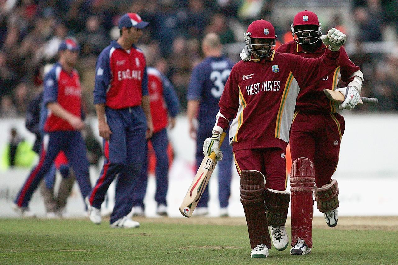 LONDON - SEPTEMBER 25:  Ian Bradshaw and Courtney Browne of West Indies celebrate victory after the ICC Champions Trophy Final between England and the West Indies at the Brit Oval, on September 25, 2004 in London.  (Photo by Clive Mason/Getty Images)