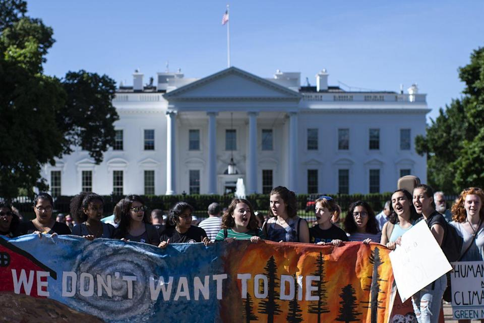 """<p>Led by youth activist Greta Thunberg, students, young people, and their families protested for greater environmental reform and for government officials to further protect out planet against climate change. Here, teenagers hold up a banner stating, """"We Don't Want to Die"""" in front of the White House. </p>"""