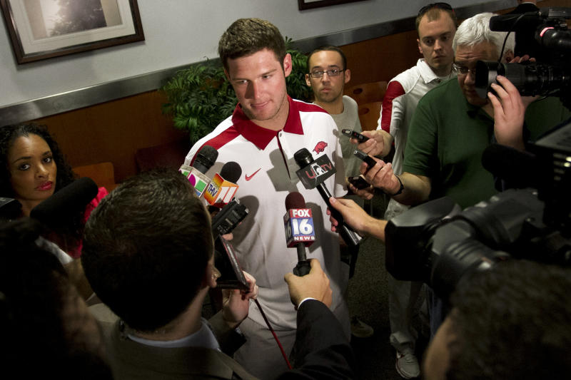 Arkansas quarterback Tyler Wilson speaks to reporters at an NCAA college football news conference in Fayetteville, Ark., Tuesday, April 24, 2012. (AP Photo/Gareth Patterson)
