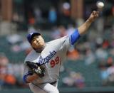 Los Angeles Dodgers pitcher Hyun-Jin Ryu, of South Korea, delivers against the Baltimore Orioles during the first inning in the first baseball game of a doubleheader Saturday, April 20, 2013, in Baltimore. (AP Photo/Gail Burton)
