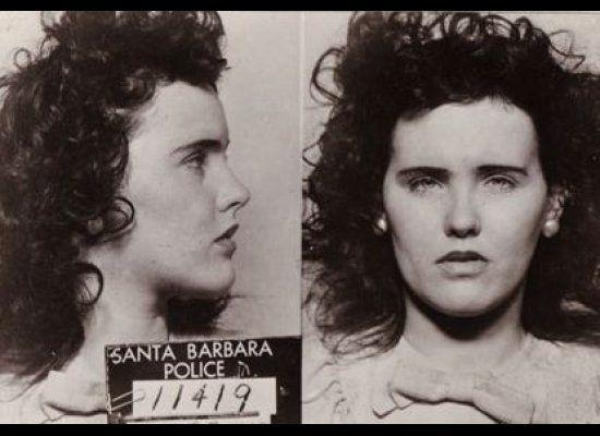 """On Jan. 15, 1947, the remains of Elizabeth Short were found in a vacant lot in Los Angeles. What made this discovery the stuff of tabloid sensation, however, was the Glasgow smile left on the aspiring actress' face ― made with 3-inch slashes on each side. This, coupled with Short's dark hair, fair complexion and reputation for sporting a dahlia in her hair, led her to be dubbed """"The Black Dahlia"""" in headlines. What followed was a media circus filled with rumors and speculation about the 22-year-old's checkered past. What haunts theorists to this day, apart from the victim's uniquely nightmarish visage, is that the case remains unsolved after some 200 suspects were interviewed and ultimately released, making it one of Hollywood's most lurid legends."""