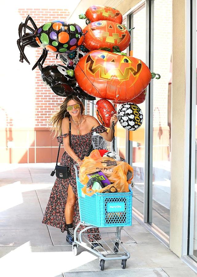 "<p>When it comes to Halloween, it's never too early for the model to begin prepping for her annual bash. She dropped the first hints about <a href=""https://www.yahoo.com/celebrity/halloween-queen-heidi-klum-teases-costume-214054923.html"" data-ylk=""slk:the costume she'll wear this year"" class=""link rapid-noclick-resp"">the costume she'll wear this year</a> on Monday, then hit the aisles of Party City for supplies. (Photo: Jean Baptiste Lacroix/ Getty Images for Party City) </p>"