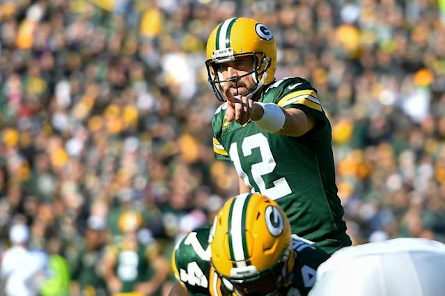 Aaron Rodgers of the Green Bay Packers calls a play in the second half against the Oakland Raiders at Lambeau Field (AFP Photo/Quinn Harris)