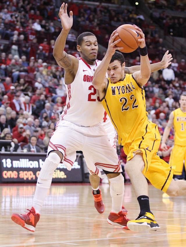 Wyoming's Larry Nance, Jr. (22) drives to the basket as Ohio State's Amir Williams (23) guards during the second half of an NCAA college basketball game, Monday, Nov. 25, 2013, in Columbus, Ohio. (AP Photo/Mike Munden)