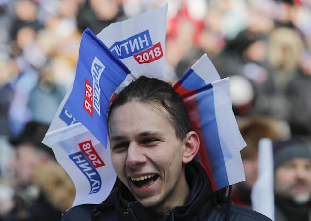 <p>A youth takes part in a rally to support Russian President Vladimir Putin in the upcoming presidential election at Luzhniki Stadium in Moscow, Russia, March 3, 2018. (Photo: Maxim Shemetov/Reuters) </p>