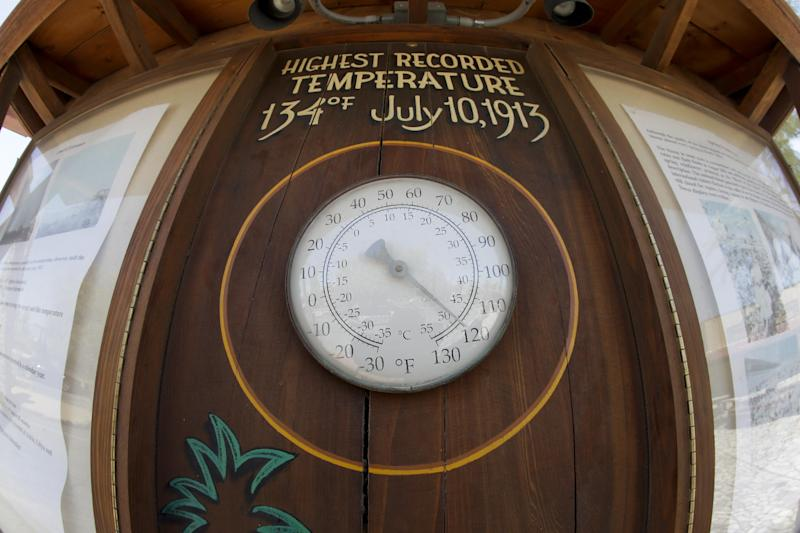 The thermometer at the Furnace Creek resort is already at 120 degrees before noon in Death Vally National Park Friday, June 28, 2013 in Furnace Creek, Calif. Excessive heat warnings will continue for much of the Desert Southwest as building high pressure triggers major warming in eastern California, Nevada, and Arizona. (AP Photo/Chris Carlson)