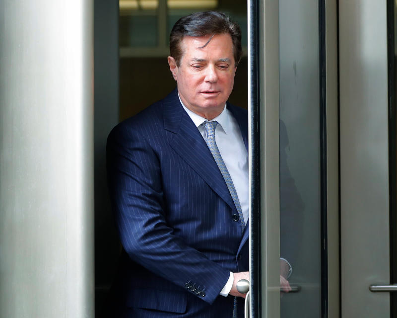FILE - In this Feb. 14, 2018, file photo, Paul Manafort leaves the federal courthouse in Washington. The trial of President Donald Trump's former campaign chairman will open this week with tales of lavish spending on properties and clothing and allegations that the political consultant laundered money through offshore bank accounts. What's likely to be missing: answers about whether the Trump campaign colluded with Russia during the 2016 presidential election.  (AP Photo/Pablo Martinez Monsivais, File)