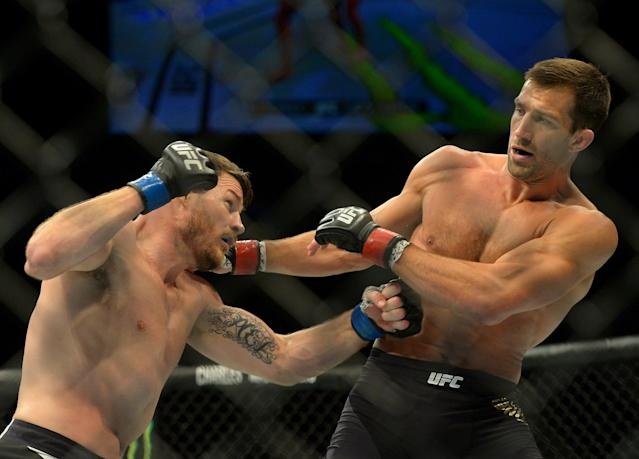 Luke Rockhold (R) would love to get another crack at UFC middleweight champ Michael Bisping. (Getty)