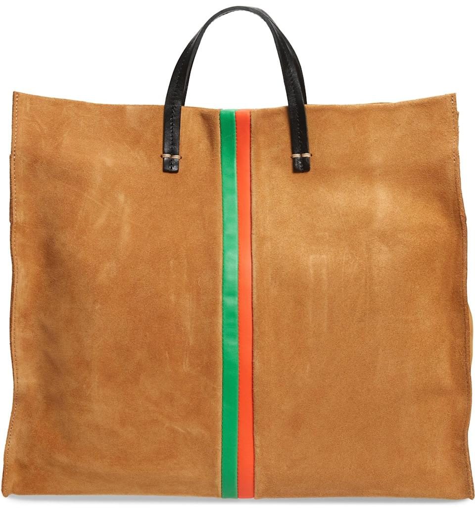 <p>We're so into the double straps on this <span>Clare V. Simple Stripe Suede Tote</span> ($495). Hold it at the top handle or shoulder strap - whichever's more comfortable for you.</p>