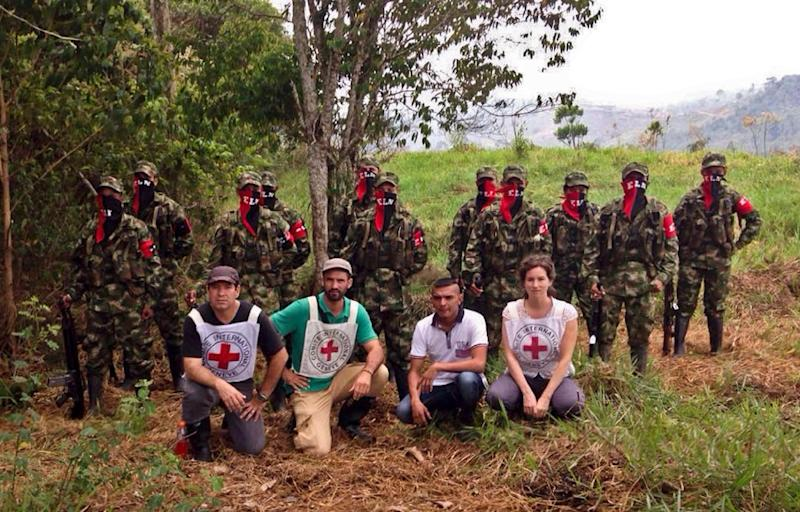 Picture released by the International Committee of the Red Cross (ICRC) showing Colombian policeman Hector German Perez (bottom, 2nd-R) during his release in a rural area of Bolivar