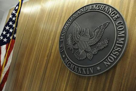 FILE PHOTO - The seal of the U.S. Securities and Exchange Commission hangs on the wall at SEC headquarters in Washington, June 24, 2011. REUTERS/Jonathan Ernst