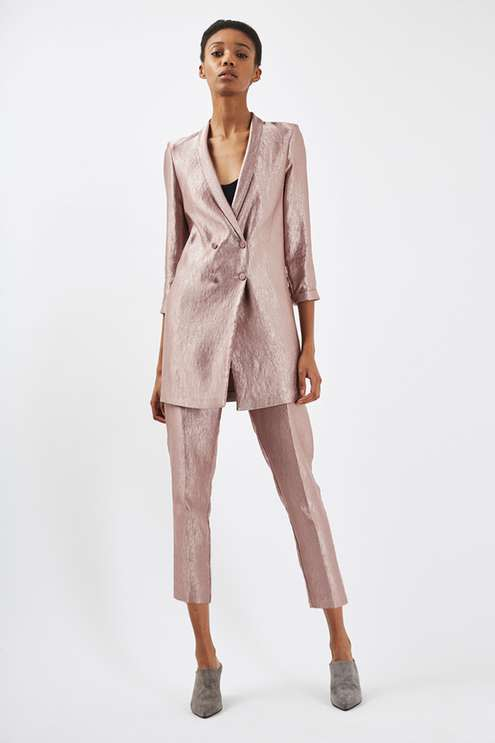 """<p><a rel=""""nofollow"""" href=""""http://www.topshop.com/en/tsuk/product/clothing-427/suits-co-ords-4062329/soft-satin-tailored-jacket-and-trousers-6062129?bi=0&ps=20&bundle=true"""">Topshop, £110</a> </p>"""