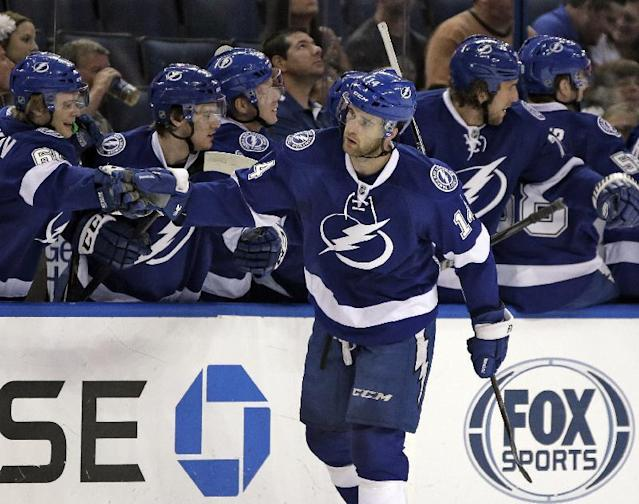 Tampa Bay Lightning right wing Brett Connolly celebrates with the bench after his goal against the Nashville Predators during the first period of an NHL preseason hockey game, Thursday, Sept. 19, 2013, in Tampa, Fla. (AP Photo/Chris O'Meara)