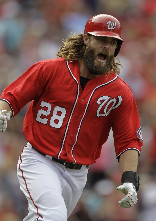 Washington Nationals' Jayson Werth celebrates his RBI single on the way to first base during the sixth inning of a baseball game against the San Francisco Giants Sunday, Aug. 24, 2014, in Washington. The Nationals won 14-6. AP Photo/Luis M. Alvarez)