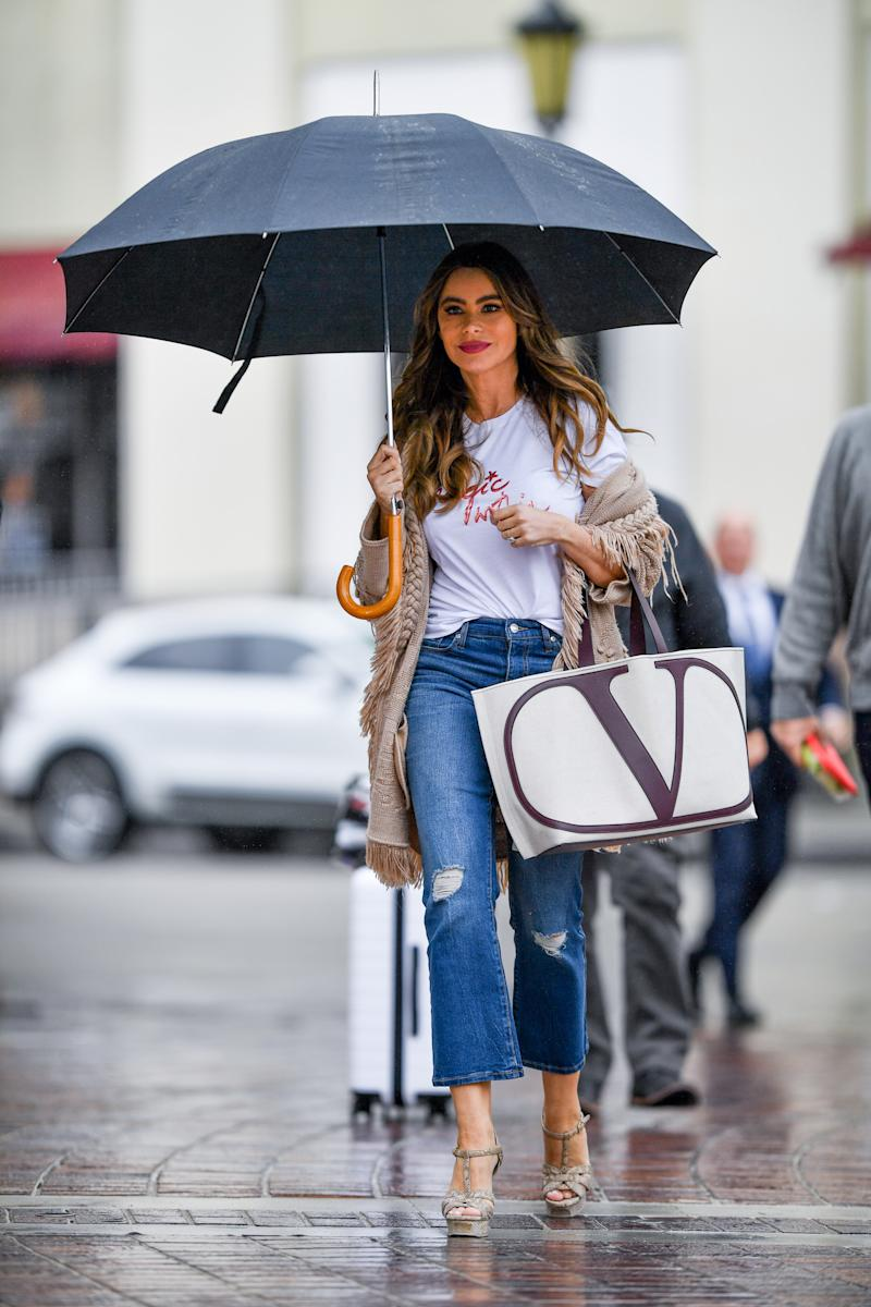 Sophia's only protection was an enormous umbrella. Photo: Getty Images