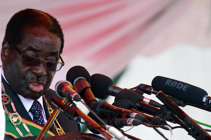 Zimbabwean President elect, Robert Mugabe reads his speech, during the country's commemoration of Heroes day, in Harare, Monday, Aug. 12, 2013. Zimbabwe's longtime President Robert Mugabe says his party will not yield its victory in elections that although disputed were endorsed by African observers and conducted without the violence that marred previous polls. (AP Photo/Tsvangirayi Mukwazhi)