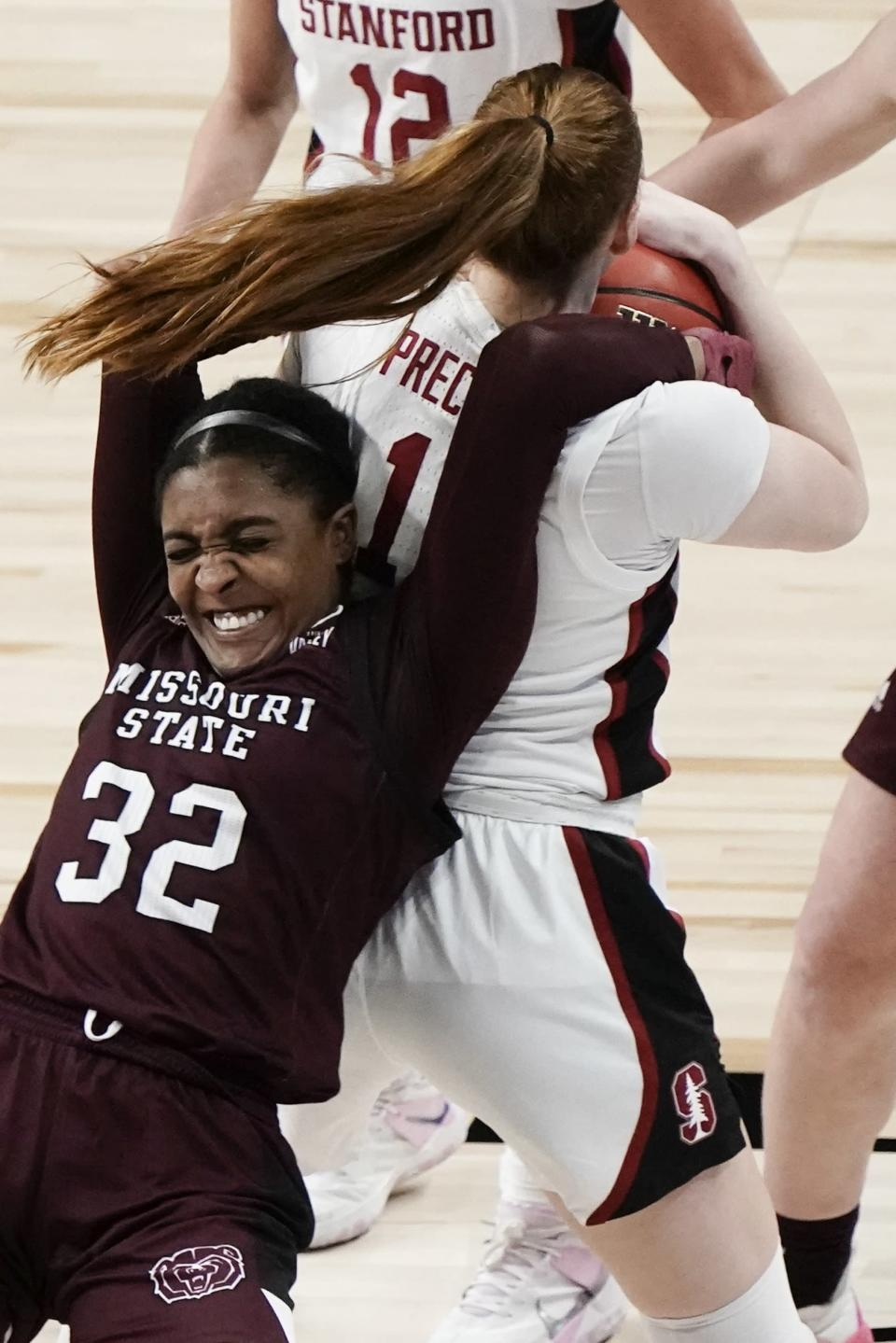 Missouri State's Jasmine Franklin and Stanford's Ashten Prechtel battle for a rebound during the second half of an NCAA college basketball game in the Sweet 16 round of the Women's NCAA tournament Sunday, March 28, 2021, at the Alamodome in San Antonio. (AP Photo/Morry Gash)