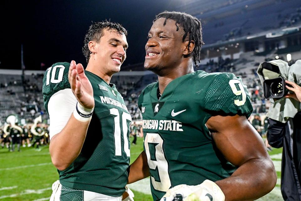 Michigan State's Payton Thorne, left, and Kenneth Walker III celebrate after beating Western Kentucky on Saturday, Oct. 2, 2021, at Spartan Stadium in East Lansing.