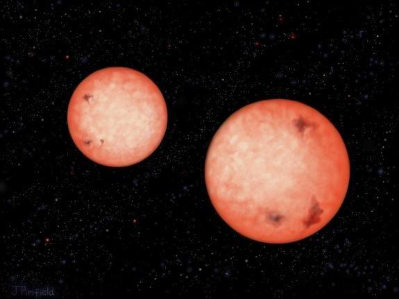 This artist's impression shows two active stars — M4-type red dwarfs — that orbit each other every 2.5 hours, as they continue to spiral inwards. Eventually they will coalesce into a single star.