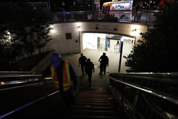 Police officers stand at the entrance to a closed subway station during a power outage Saturday, July 13, 2019, in New York. (Photo: Michael Owens/AP)