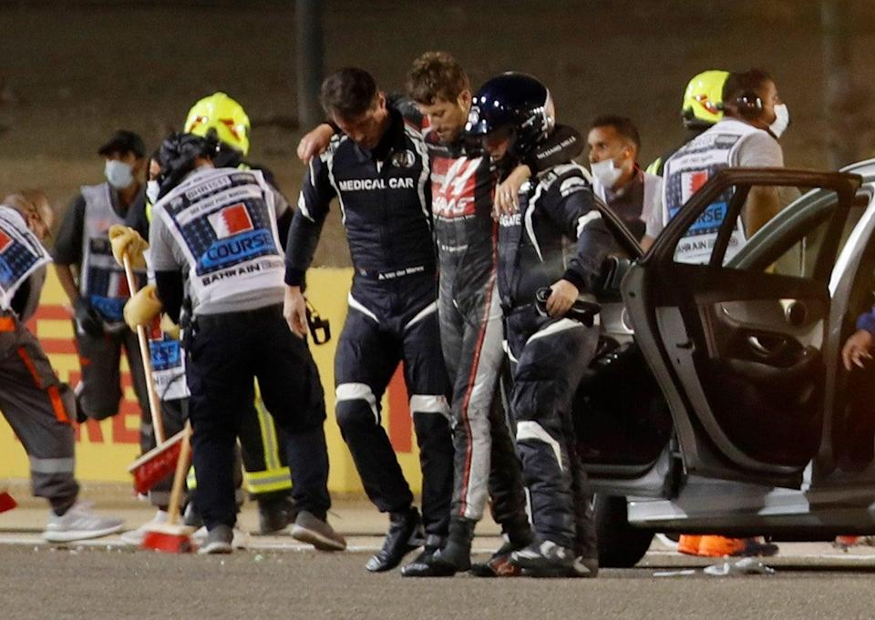 Grosjean was helped away from the scene before being airlifted to hospital (Reuters)