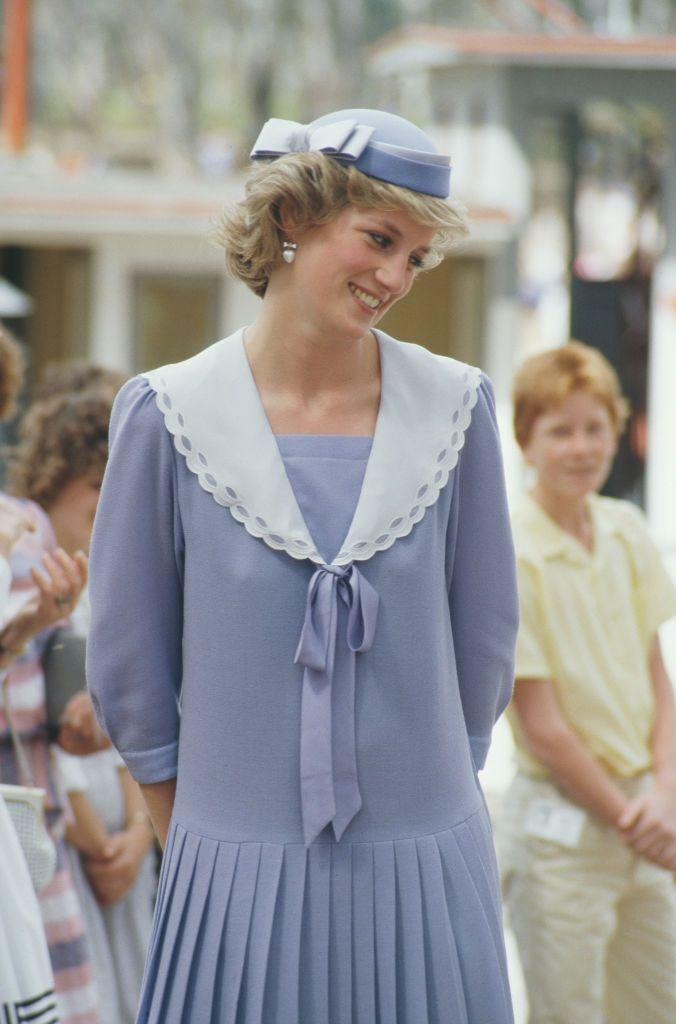 <p>Diana appeared at Mildura in Victoria, Australia, in October 1985 wearing a drop waist dress with a wide sailor collar with a vintage feel. </p>