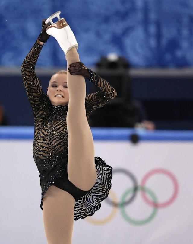 Natalia Popova of Ukraine competes in the women's short program figure skating competition at the Iceberg Skating Palace during the 2014 Winter Olympics, Wednesday, Feb. 19, 2014, in Sochi, Russia. (AP Photo/Bernat Armangue)